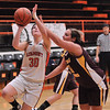 Altamont's Chandra Smith drives past Dieterich's Taylor Wright.