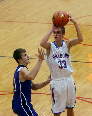 Andrew Gardewine attempts a shot in the first quarter of the Bulldogs' 60-37 loss to Breese Central in the seventh-place game at the St. Anthony Thanksgiving Tournament. Gardewine scored six first-quarter points after coming off the bench for the Bulldogs.
