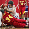 St. Anthony's Patrick Martelli fights for the ball during the Bulldogs' 92-54 loss to Charleston.