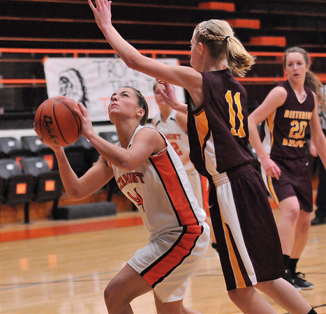 Altamont's Lauren Ohnesorge head fakes against Dieterich's Courtney Flach on at Altamont High School