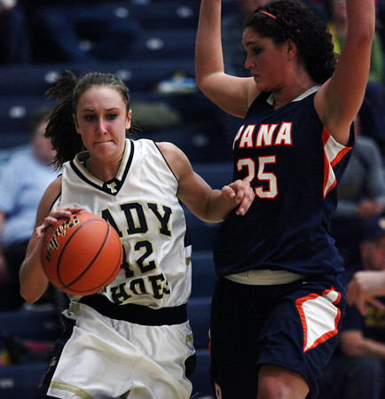Teutopolis' Madeline Hartke dribbles around Pana's Nadine Vaughn Thursday during the Wooden Shoes' 48-52 overtime loss. Hartke totalled 27 points for the game.