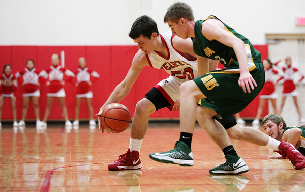 Effingham's Clark Williamson dribbles the ball past a defender during Effingham's 48-47 win over Mattoon in the St. Anthony Thanksgiving Tournament.