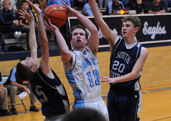St. Elmo's Reece Wells slices between a pair of South Central defenders.