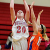 St. Anthony's Megan Nuxoll, left, attempts a layup against Newton's Carly Niebrugge at St. Anthony High School. Nuxoll scored 13 points in the Bulldogs' 41-30 victory.