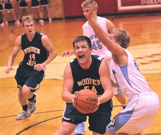 Teutopolis' Kyle Pruemer spins towards the basket in his team's championship game win against Pinckneyville at the Lawrenceville Capital Classic. Pruemer made the all-tournament team, along with teammates Derek Smith and Jared Waldhoff. Smith was named MVP.