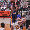 Cowden-Herrick's Luke Moore puts up a shot in the lane Tuesday against Patoka at the Ramsey/Mulberry Grove Thanksgiving Tournament.