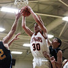 Jon Kuhns (30) of Altamont grabs a rebound over Colton Ingram (12) of Cumberland. Kuhns scored 17 points in the Indians' 65-37 victory at Altamont High School.