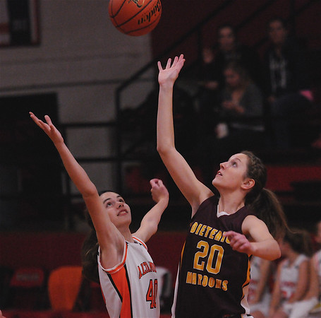 Dieterich's Candace Niemerg and Altamont's Renee Tillman battle for the opening tip at the NTC Tournament at Beecher City.