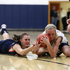 Teutopolis' Anna Hartke tussles for a tossup Thursday during the team's 52-48 overtime loss to Pana.