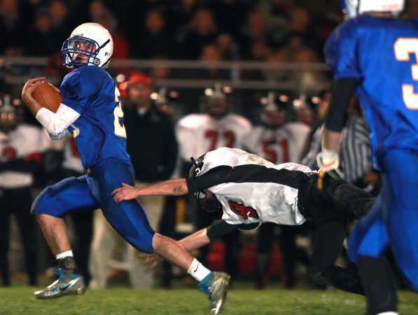 11-8-13<br /> Tri Central vs. Clinton Prairie sectional championship game<br /> Tri-Central's Garrett Kelley runs the ball as Clinton Prairie's Collin Laflen tries to pull him down.<br /> KT photo | Kelly Lafferty