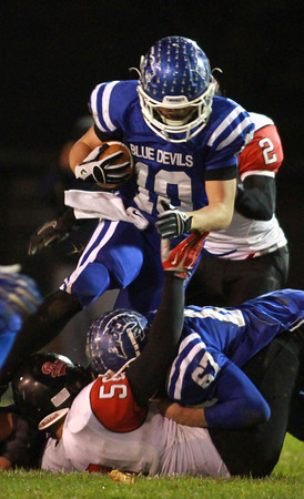 11-22-13<br /> Tipton Semistate<br /> Tipton's Nate Hein jumps over Rensselaer's defense.<br /> KT photo | Kelly Lafferty