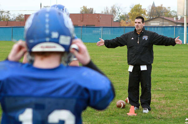 11-5-13<br /> Tipton football practice<br /> Aaron Tolle coaches his players on the Tipton High School football team.<br /> KT photo | Kelly Lafferty
