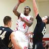11-6-13<br /> IUK basketball vs. Purdue Calumet<br /> IUK's Kendall Broome shoots as Purdue Calumet's Drew Ridlen tries to block him.<br /> KT photo | Kelly Lafferty