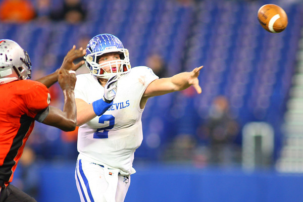 11-30-13<br />   Tipton HS Football State Championship Runner-up<br /> Austin Hooker throwing a pass in the 4th quarter.<br />   KT photo | Tim Bath