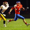 11-1-13  --  Sectional Football between KHS and McClutcheon  --  McClutcheon's Alex Nicoson chasing down Kokomo's Bo Baker in the 3rd quarter.<br />   KT photo | Tim Bath