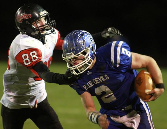 11-22-13<br /> Tipton Semistate<br /> Rensselaer's Austin Fleming tries to tackle Tipton's Austin Hooker.<br /> KT photo | Kelly Lafferty