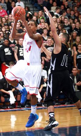 11-27-13<br /> Kokomo vs. Western basketball<br /> Kokomo's Mykal Cox eyes the basket.<br /> KT photo | Kelly Lafferty