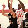 11-6-13<br /> IUK basketball vs. Purdue Calumet<br /> IUK's Jordan King goes up for a rebound against Purdue Calumet's Danny Paschen.<br /> KT photo | Kelly Lafferty