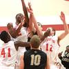 11-6-13<br /> IUK basketball vs. Purdue Calumet<br /> IUK's David Kelly jumps up to get the rebound.<br /> KT photo | Kelly Lafferty