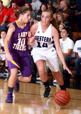 11-26-13<br /> Western vs. Northwestern basketball<br /> Northwestern's Sophia Beachy and Western's Jessica Givens.<br /> KT photo | Kelly Lafferty