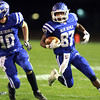 11-15-13<br /> Tipton vs. Oak Hill regional football<br /> Tipton's Jake Devendorf runs the ball.<br /> KT photo | Kelly Lafferty