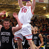11-27-13<br /> Kokomo vs. Western basketball<br /> Kokomo's Erik Bowen pushes through Western defense to the basket.<br /> KT photo | Kelly Lafferty