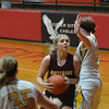 Dieterich's Mallorie Vahling drives to the basket while being defended by CHBC's Jensyn Morrison at the NTC Tournament in Beecher City.