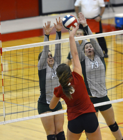 Stew-Stras' Baylee Quast (left) and Clara Kaufman (right) block an attack from Liberty's Madelyn Hyer (5) as the Comets defeated Liberty in the Class 1A Nokomis Super-Sectional and advanced to state.
