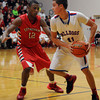 St. Anthony's Zach Gardewine looks to make a move while being guarded by Effingham's Marcus Robinson.