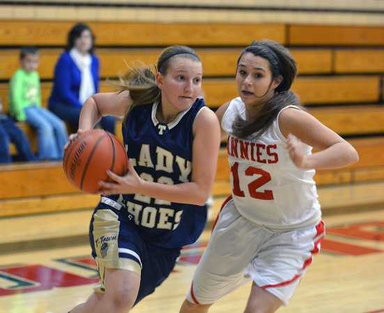 Teutopolis' Danielle Repking takes the ball to the hoop while being guarded Centralia's Raigen Schwartz at Salem's Lady Wildcat Thanksgiving Tournament.
