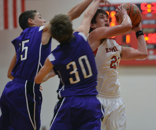 Effingham's Matt Wohltman goes up for a layup while being defended by Breese Central's Robbie Harmon (15, left) and Mitchel Rule (30, center) at the St. Anthony Turkey Tournament.
