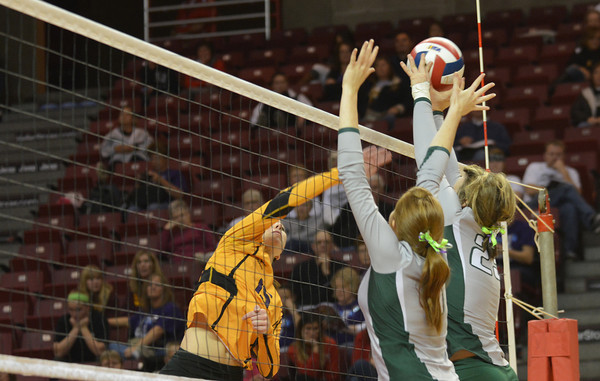Morgan Stremming (9) and Baylee Quast (23) block a hit by New Athens' Denae White (15) during the IHSA Class 1A state semifinal at Redbird Arena in Normal.