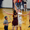 Dieterich's Devin Aherin (33) and Travis Niemerg (50) jump for the tipoff during Meet the Maroons night.