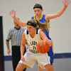 South Central's Jenna Rose (11) attempts to elude the defense of CHBC's Ashley Miller.