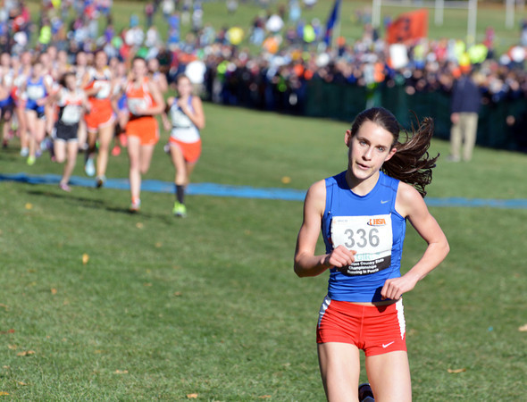 St. Anthony's Anna Sophia Keller extends her lead on the rest of the pack during the first mile of the Class 1A state championship meet in Peoria. Keller set a state record for Class 1A while winning the state title.