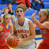 Newton's Andrea Cartright takes the ball to the basket during the Eagles' season-opening loss to St. Anthony.