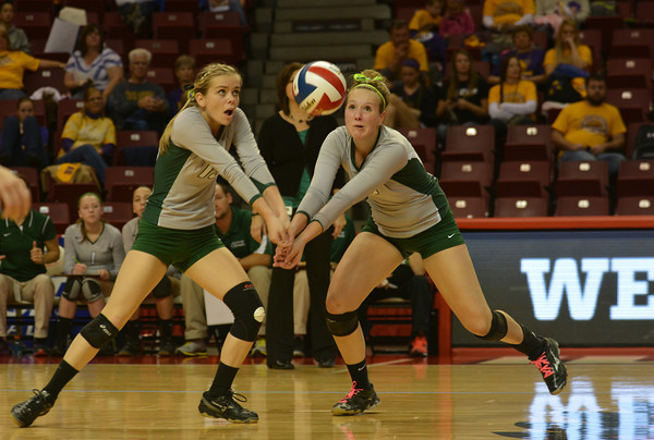 Kendall Knop (13) and Brittani Tabbert (10) go for a ball in the first set of the IHSA Class 1A state championship game in Normal against Keith Country Day.