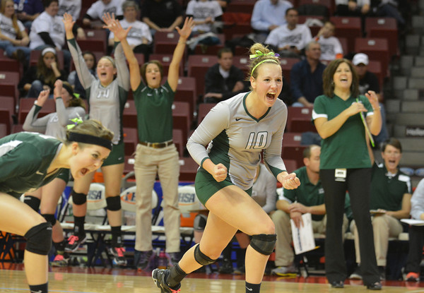 Brittani Tabbert (10) celebrates after a point late in the first set of the Stew-Stras and New Athens IHSA Class 1A state semifinal at Redbird Arena in Normal.
