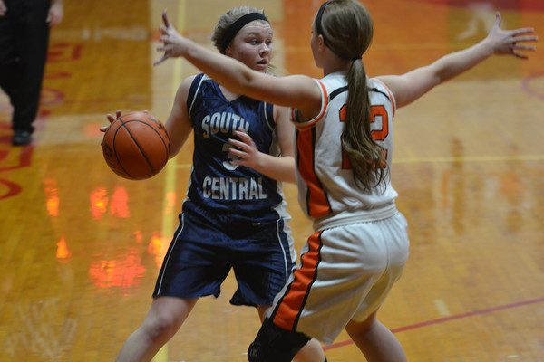 South Central's Abby Hahn is closely guarded by Altamont's Danielle Vaughn at the NTC Tournament in Beecher City.