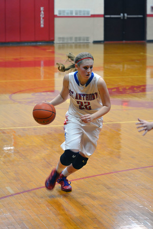 St. Anthony's Kate Richards brings the ball up court against Dieterich at the NTC Tournament.