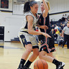 Senior Madeline Hartke tries to dribble around a Sullivan defender during the second quarter in JH Griffin Gymasium at Teutopolis High School.
