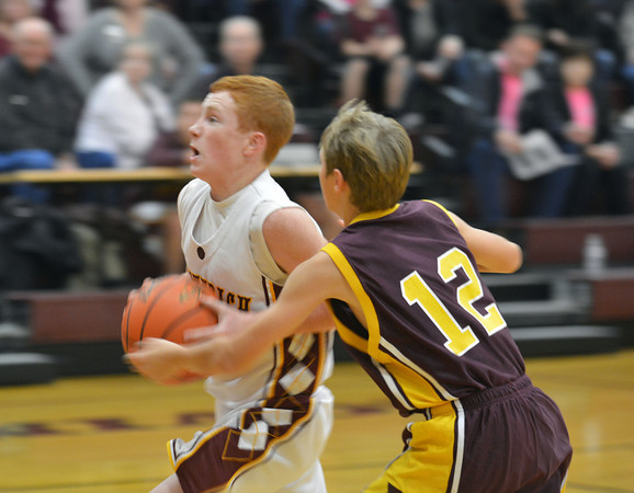 Dieterich's Clayton Campton drives past Evan Kuhl during Meet the Maroons night.