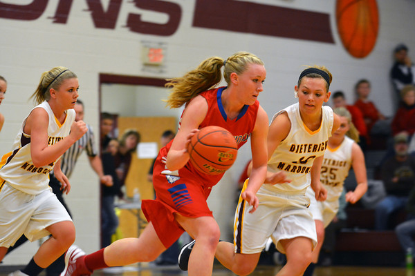 St. Anthony's Megan Nuxoll takes off on a fast break while being defended by Dieterich's Elizabeth Abbott.