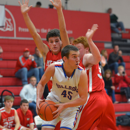 St. Anthony's John Goeckner looks to pass his way out of a Mt. Zion double team at the St. Anthony Turkey Tournament.