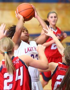 11-19-14 Kokomo vs Cass basketball Kokomo's Gabrielle Smith shoots over Lewis Cass defenders. Kelly Lafferty Gerber | Kokomo Tribune
