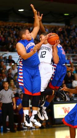 11-26-14<br /> Western HS hosting Kokomo HS Boys basketball. Kokomo's Marcelle Kenner blocking Western's Des Balentine.<br /> Tim Bath | Kokomo Tribune