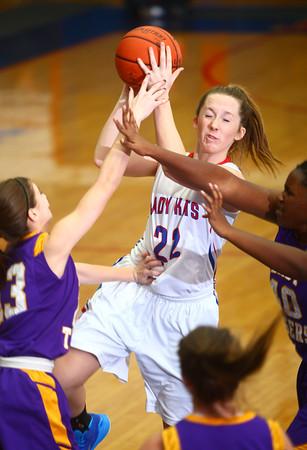 11-14-14<br /> Kokomo vs. Northwestern girls basketball<br /> Kokomo's Emily Bailey gets fouled as she goes for a shot.<br /> Kelly Lafferty Gerber | Kokomo Tribune