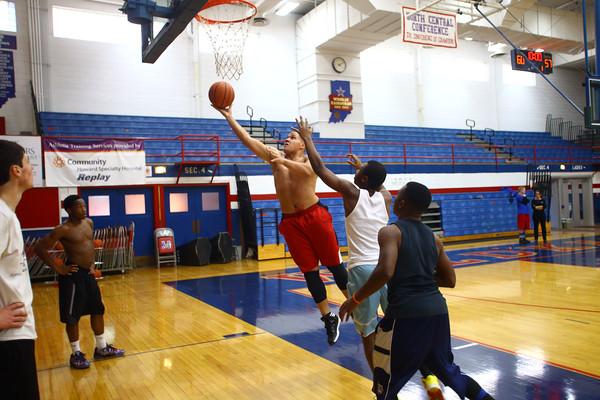 11-10-14<br /> First day of Kokomo High School basketball practice at Memorial Gym. Marcelle Kenner putting up a shot in practice.<br /> Tim Bath   Kokomo Tribune