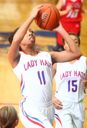11-19-14<br /> Kokomo vs Cass basketball<br /> Kokomo's Quaynika Merriweather shoots.<br /> Kelly Lafferty Gerber | Kokomo Tribune