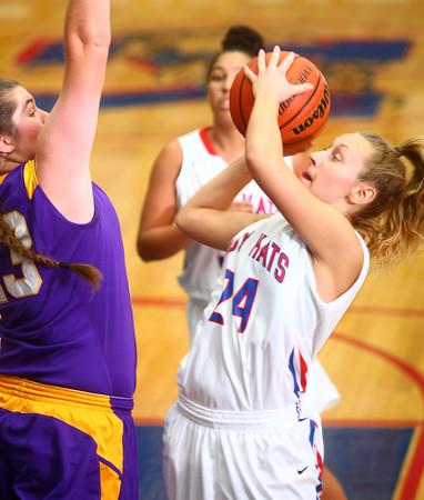 11-14-14<br /> Kokomo vs. Northwestern girls basketball<br /> Kokomo's Sarah Tickfer tries to shoot over Northwestern's Brooke Treadway.<br /> Kelly Lafferty Gerber | Kokomo Tribune